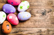 Easter eggs painted on the wooden background.