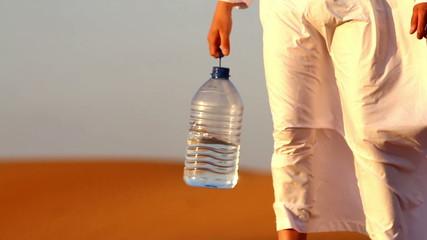 Arab man in the desert, thirsty man  in the desert water