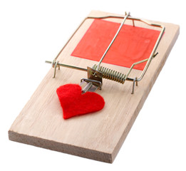 Mousetrap with heart isolated on white