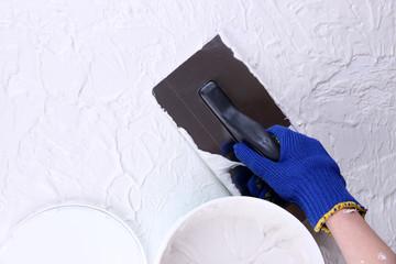Construction trowel and worker hands