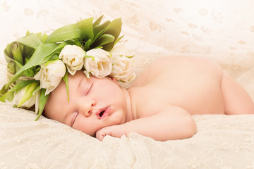 Newborn baby with flowers