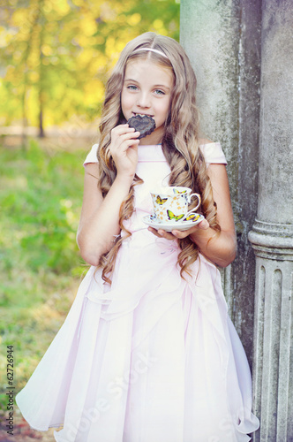 Beautiful girl eats a cake