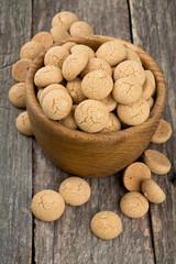 Traditional italian almond cookies - amaretti, on wooden surface
