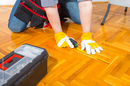 Male Worker laminate, parquet flooring