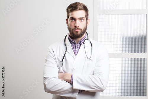 Portrait of a happy young male doctor