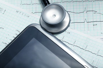 Tablet computer, stethoscope, cardiogram. Technologies in medici