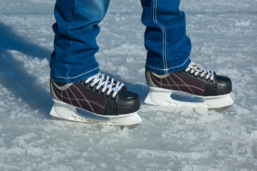 Feet in ice skating rink