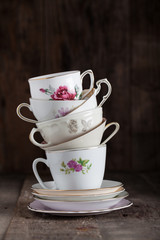 Stack of a variety of flower tea cups..