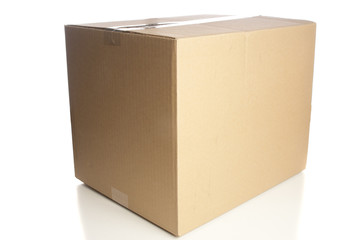 Closed cardboard box on white background