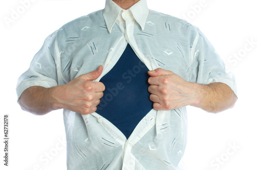 Man tearing off his shirt on white background