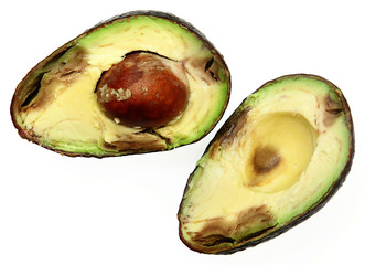 Overly Ripe Avocado Sliced with Seed Over White