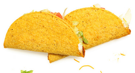 Two Tacos Stacked on White Background with cheese and lettuce