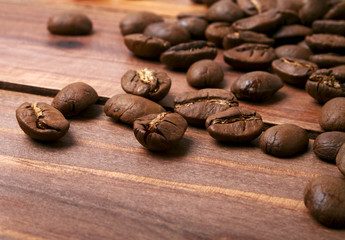 Coffee beans on a wood background