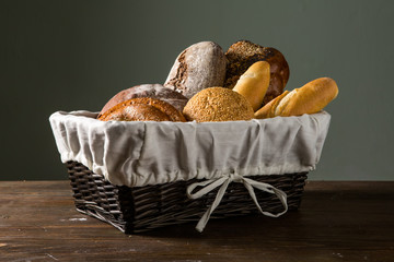 Photo of the assorted bread in wooden basket