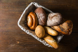 Naklejka Photo of the assorted bread in wooden basket