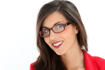 Attractive brunette woman with red jacket and eyeglasses
