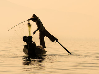 Inle Lake Myanmar - Traditional burmese fisherman balancing on t