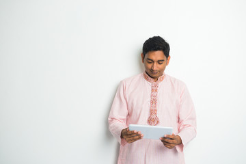 traditional indian male with tablet and plenty of copyspace