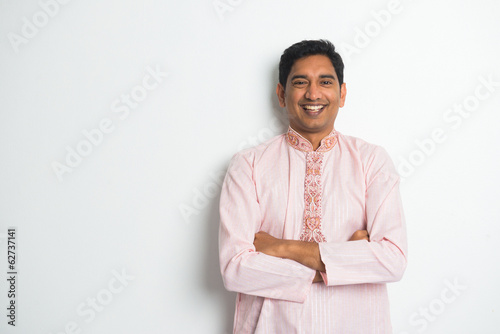 traditional indian male casual portrait with plain background an