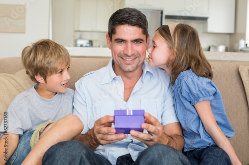 Father receiving gift from loving children