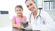 Vet and girl with kitten in clinic