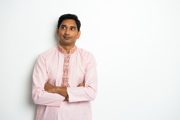 traditional indian male thinking with plain background and copys
