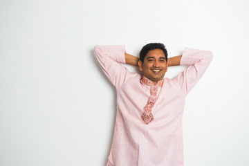young indian man with relaxed pose and traditional dress