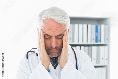 Close-up of a male doctor with severe headache