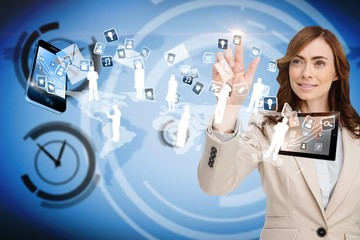 Smiling businesswoman pointing to apps flying between devices