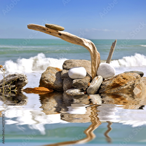 Stone and wood zen still life on a beach