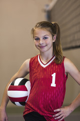 Teenaged girl on volleyball court