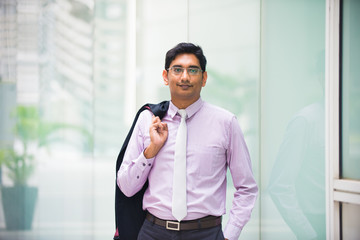 casual indian business male with coat off