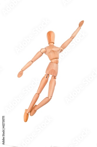 wood model figure jumping to the sky