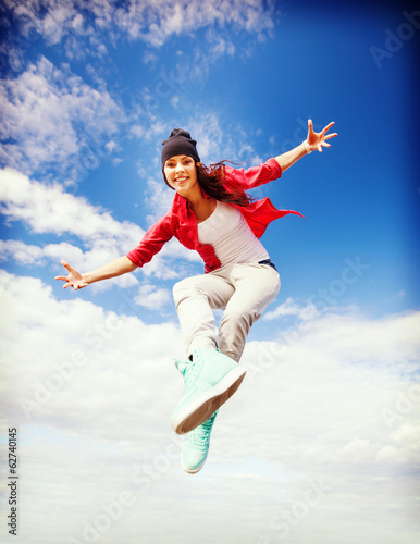 beautiful dancing girl jumping
