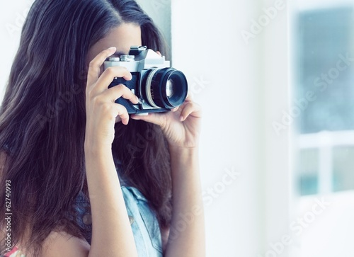 Stylish young woman taking a photo
