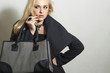 Beautiful Blond Woman in Topcoat.with Handbag.Spring Shopping