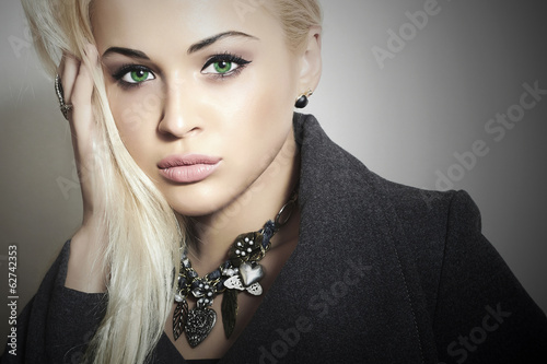 Beautiful Blond Woman in Topcoat. Girl with Jewelry