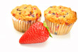 Whole Strawberry in Front of Two Berry Muffins