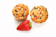 Two Berry Muffins with a Fresh Strawberry