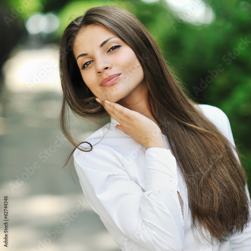 Portrait of happy smiling beautiful young woman touching skin
