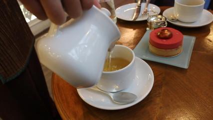 Waitress Pours Tea into Cup