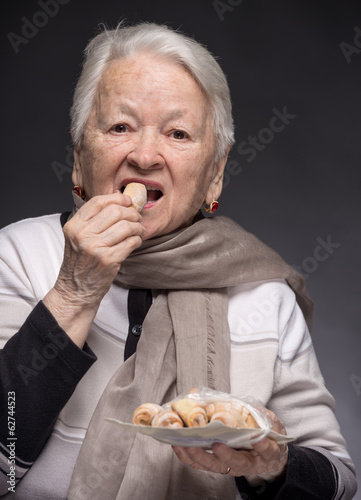 Old woman tasting cookies