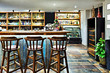 bar counter with chairs in empty comfortable restaurant - 62745121