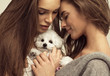 Beautiful women with a cute puppy