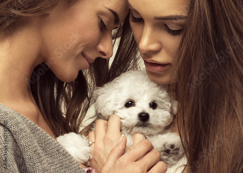 Portrait of young women with cute puppy