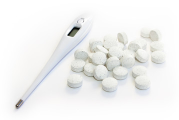 Electronic Thermometer and pills white background