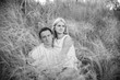 Loving couple on grass in summer