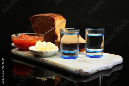 Composition with glasses of vodka, red caviar, fresh bread
