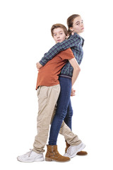 teenager siblings hugging back on back, isolated on white