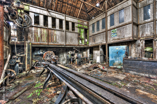 Old machinery in derelict workshop